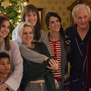 (l to r) Eric (BURL MOSELEY), Magnus (ANIS N'DOBE), Sloane (ALISON BRIE), MATILDA (ASIYIH N'DOBE), Abby (KRISTEN STEWART), Harper (MACKENZIE DAVIS), Jane (MARY HOLLAND), Ted (VICTOR GARBER) and Tipper (MARY STEENBURGEN) pose at last for their family Christmas picture in TriStar Pictures' HAPPIEST SEASON.